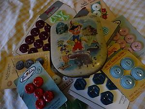 Pinochio tin & vintage buttons