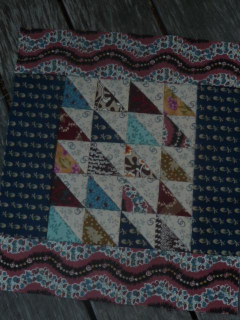 Scrappy Triangles mini quilt top