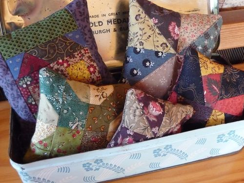 Five little scrappy pincushions