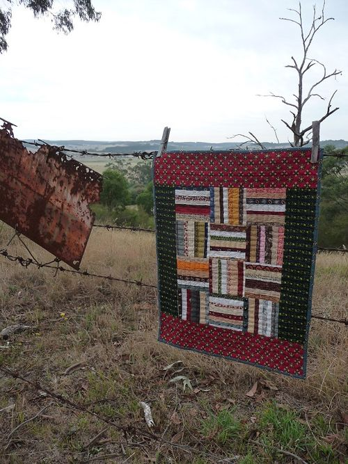 Strippy selvedge 'rail fence' quilt