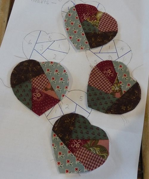 Four small crazy patch hearts