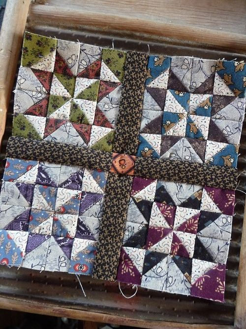 Pinwheel star blocks with sashing
