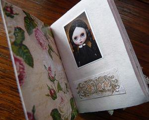 Inside her tiny scrapbook