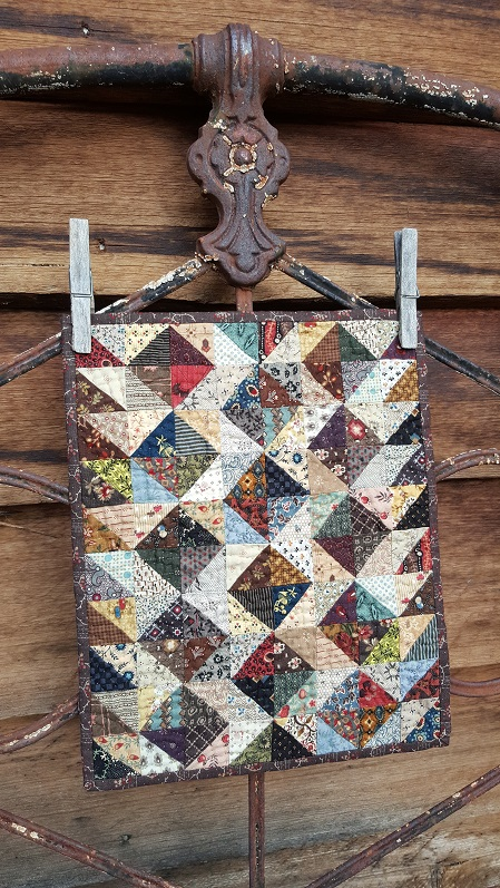 Scrappy doll quilt for Judith